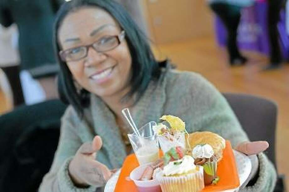 """Patricia Stephenson Gordon, affirmative action specialist, fills her plate at """"A Taste of Middletown."""" Photo by Olivia Drake/Special to the Press"""
