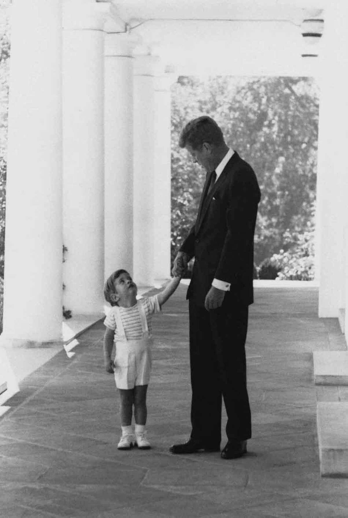 President John F. Kennedy and son, John Jr. (AP Photo)