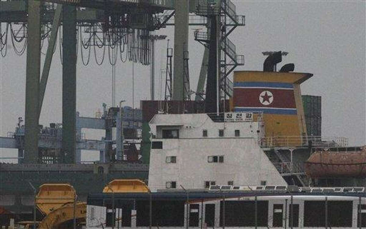 The North Korean-flagged cargo ship Chong Chon Gang, yellow, sits docked at the Manzanillo International container terminal on the coast of Colon City, Panama, early Tuesday, July 16, 2013. Panama's president said the country has seized the ship, carrying what appeared to be ballistic missiles and other arms that had set sail from Cuba. (AP Photo/Arnulfo Franco)