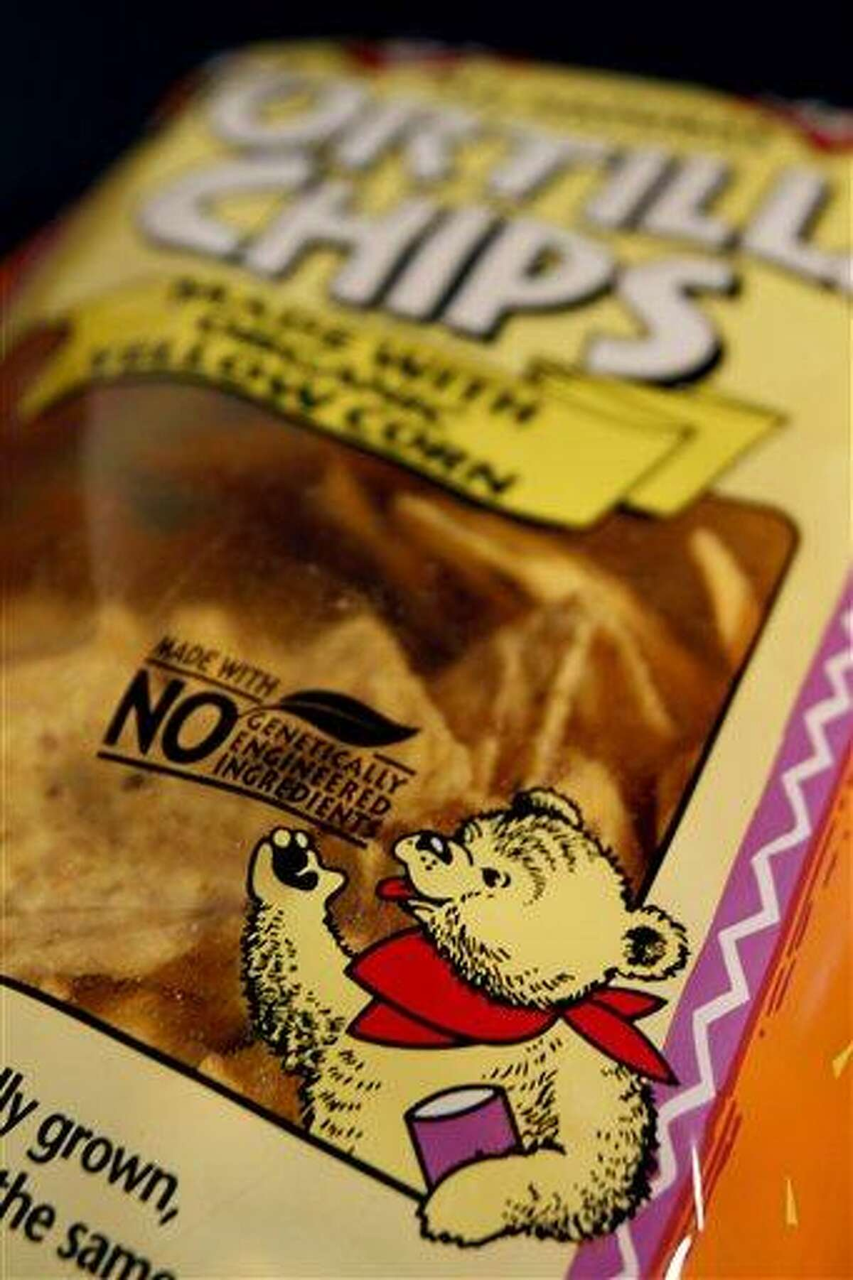 A genetically engineered label is seen on a package of tortilla chips in Montpelier, Vt. Eighteen states are considering legislation that would require labeling of genetically modified foods, even though no study says genetically modified food is unhealthy or unsafe. Associated Press file photo