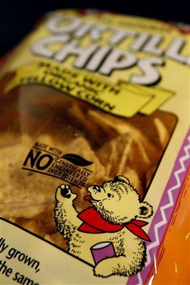 A genetically engineered label is seen on a package of tortilla chips in Montpelier, Vt. Eighteen states are considering legislation that would require labeling of genetically modified foods, even though no study says genetically modified food is unhealthy or unsafe. Associated Press file photo Photo: AP / AP