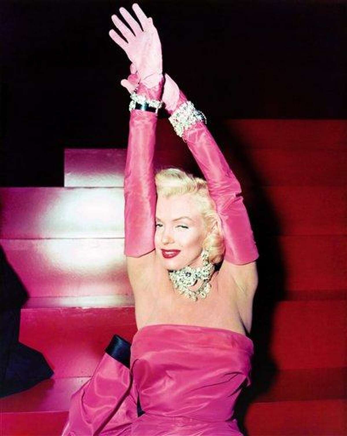 """In this 1953 publicity file photo provided by Running Press, Marilyn Monroe is shown on set of the film, """"Gentlemen Prefer Blondes."""" Monroe is probably best remembered for her comic turns in this film. The picture is included in a new 2012 book, """"Marilyn in Fashion,"""" published by Running Press. (AP Photo/Courtesy Running Press)"""