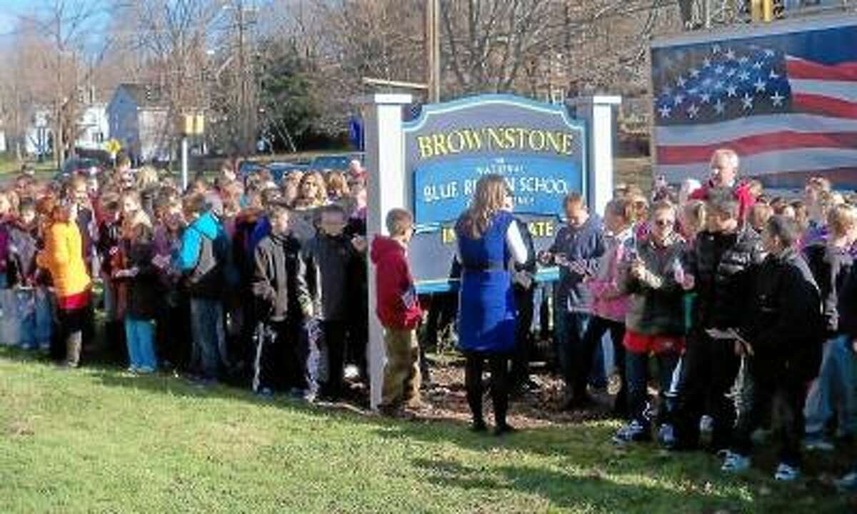 Brownstone Intermediate students in Portland welcome Wreaths Across America, an organization that places wreaths on America's fallen soldiers during the Christmas season. Jeff Mill/The Middletown Press