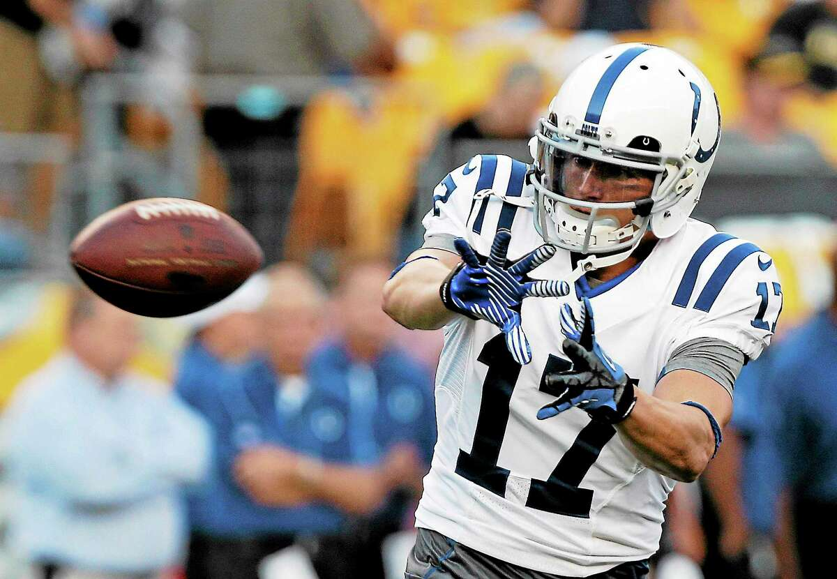 In this Aug. 19, 2012, file photo, Indianapolis Colts wide receiver Austin Collie warms up before a preseason game against the Steelers in Pittsburgh.