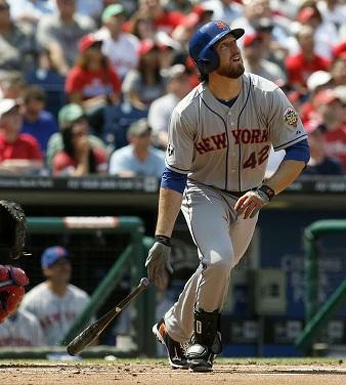 New York Mets' Ike Davis watches his two-run home run against the Philadelphia Phillies in the first inning of a baseball game on Sunday, April 15, 2012, in Philadelphia. (AP Photo/H. Rumph Jr)