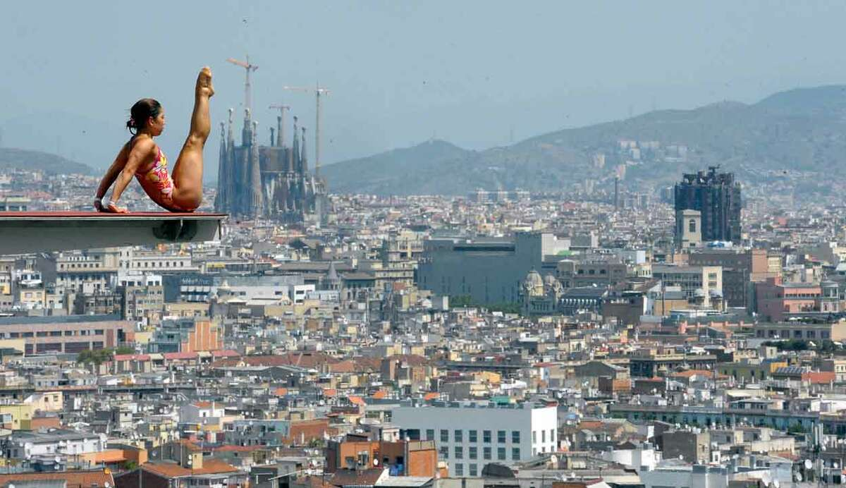 The Sagrada Familia cathedral is seen in the background as an unidentified diver practices ahead of the FINA World Championships in Barcelona, Spain, Monday, July 15, 2013. The FINA swimming World Championships run from July 19 to Aug. 4 in Barcelona. (AP Photo/Manu Fernandez)