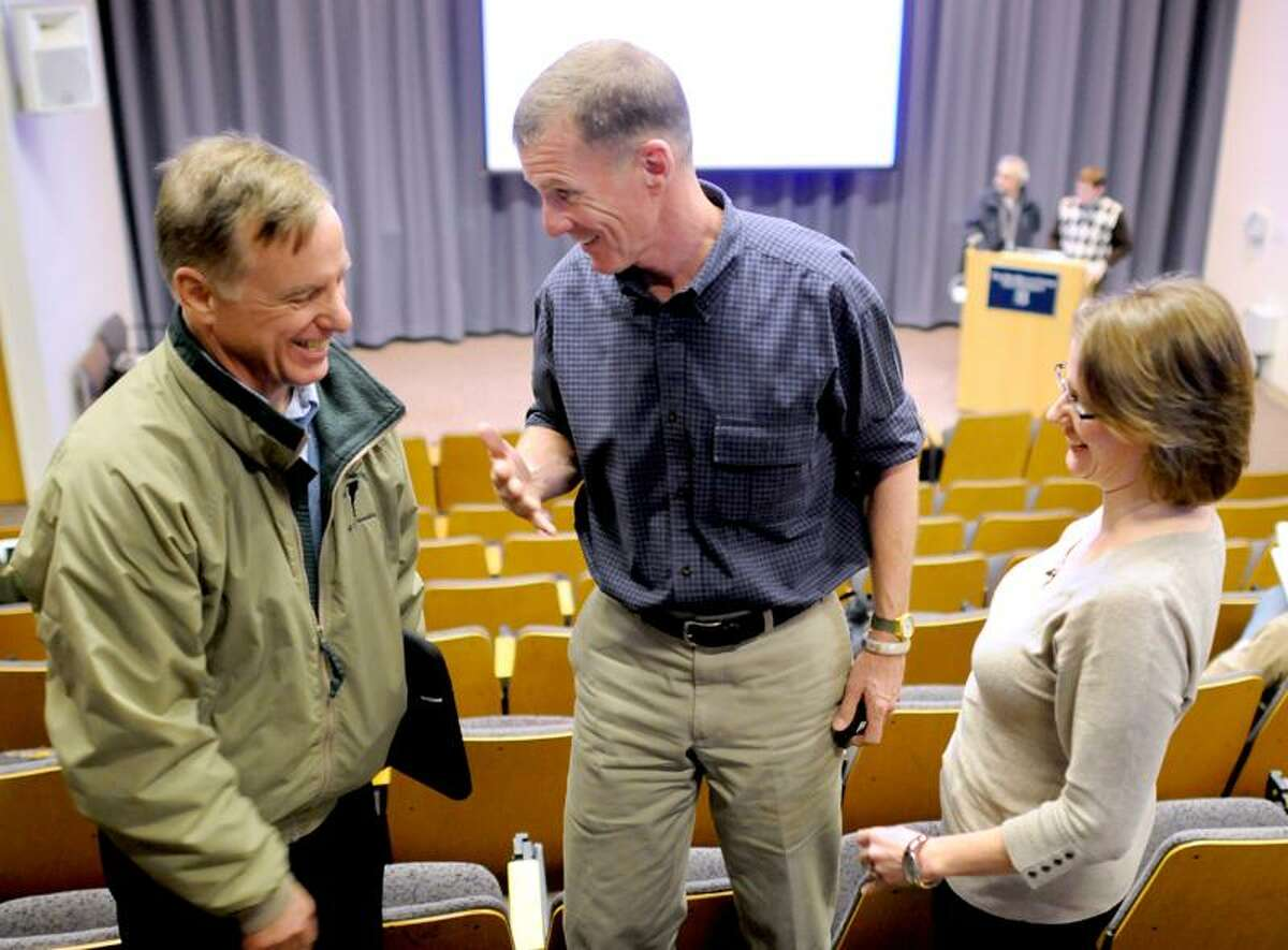 """Howard Dean, former Vermont Governor and Chairman of the Democratic National Committee, left, speaks with retired Army General Stan McChrystal and Research Scientist Kristina Talbert-Slagle before McChrystal and Talbert-Slage make their joint presentation """"The Health of Nations"""" on the similarities in fighting a medical virus and fighting a military insurgency at Yale University's Luce Hall in New Haven Tuesday March 5, 2013. Photo by Peter Hvizdak / New Haven Register"""