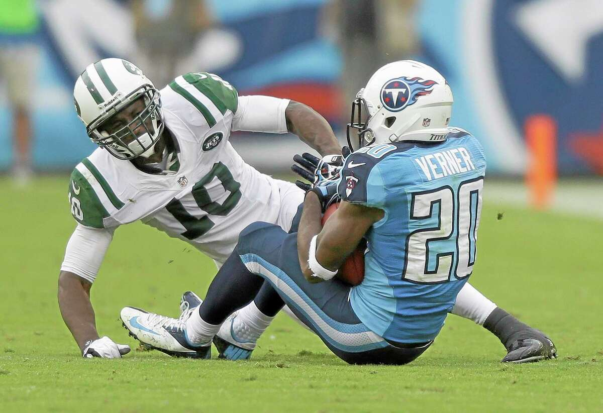 Tennessee Titans cornerback Alterraun Verner intercepts a pass intended for New York Jets wide receiver Santonio Holmes in the second quarter of Sunday's game in Nashville, Tenn.