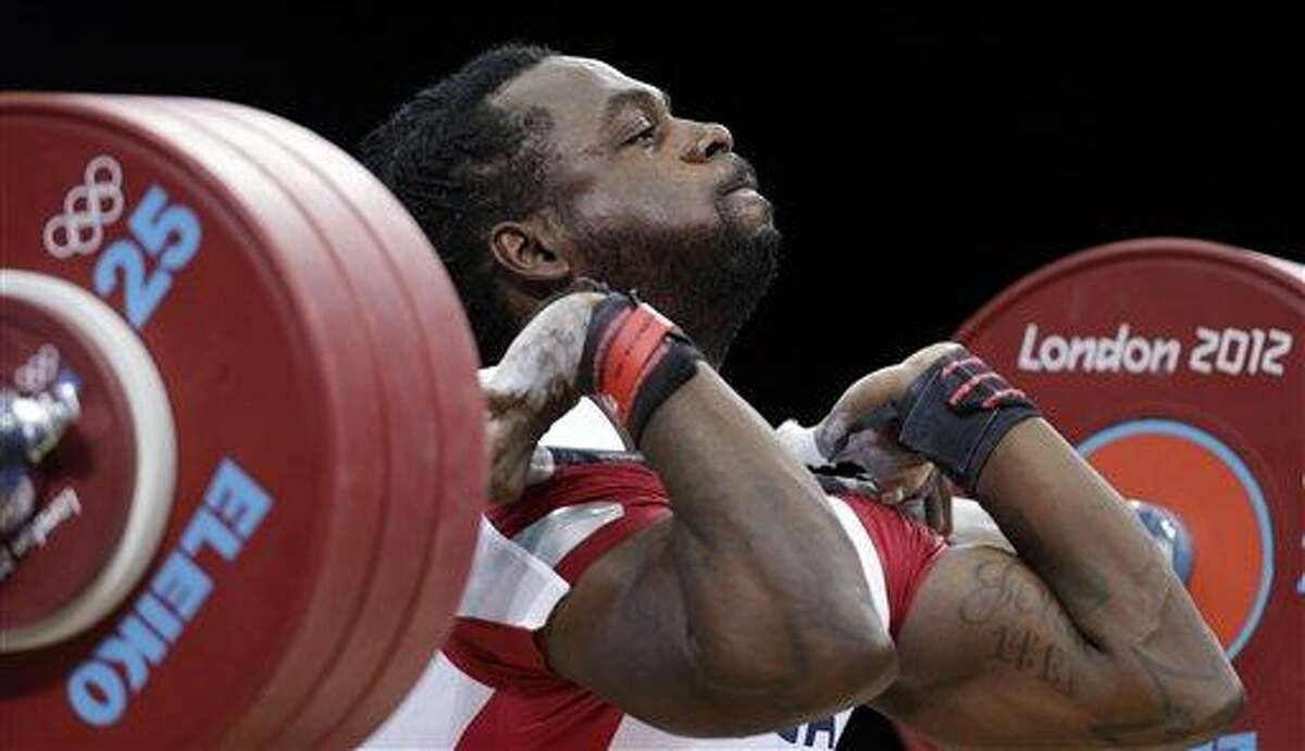 Kendrick Farris of the United States competes during the men's 85-kg, group B, weightlifting competition at the 2012 Summer Olympics, Friday, Aug. 3, 2012, in London. (AP Photo/Hassan Ammar)