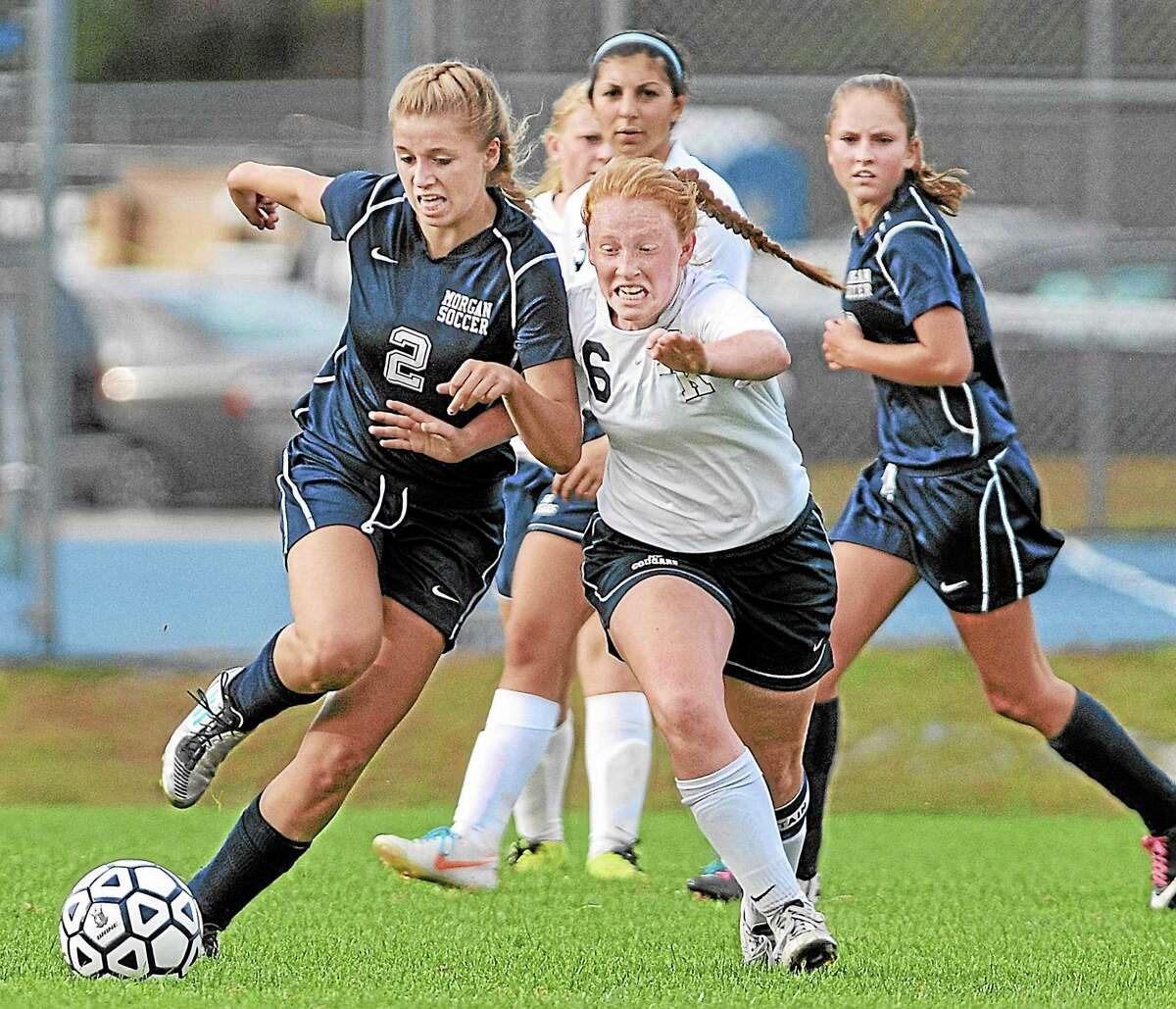 Haddam-Killingworth's Gwen Plum defends Morgan's Riley Thompson in Thursday's Shoreline Conference game in Higganum. The Cougars defeated the Huskies 4-2. All goals were scored in the second half of Thursday's game.