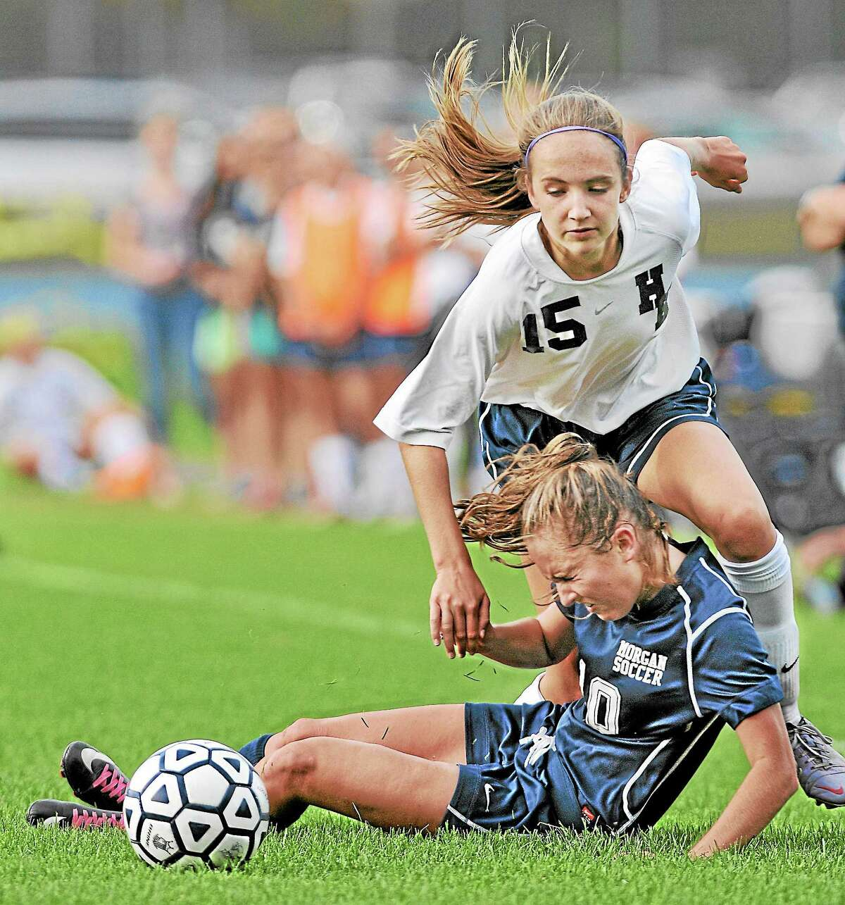 Haddam-Killingworth's Emma Martone battles Morgan's Savannah Skidmore in Thursday's Shoreline Conference game in Higganum. The Cougars defeated the Huskies 4-2. All goals were scored in the second half of Thursday's game.