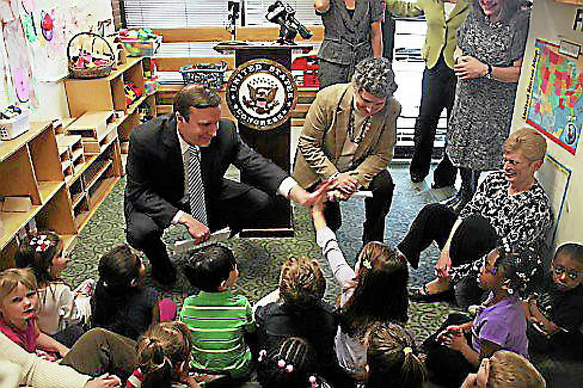 U.S. Rep. Chris Murphy and Sen. Beth Bye at a day care center last year. Michael Lee-Murphy/CT NewsJunkie file photo