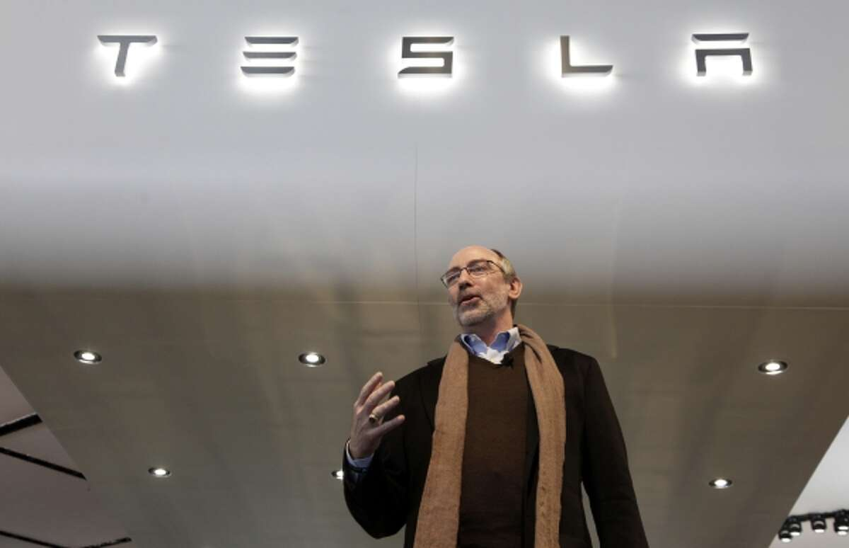 In this Tuesday, Jan. 15, 2013 photo, George Blankenship, Tesla Motors Vice President, Worldwide Sales & Ownership Experience speaks at media previews for the North American International Auto Show in Detroit. (AP Photo/Paul Sancya, File)