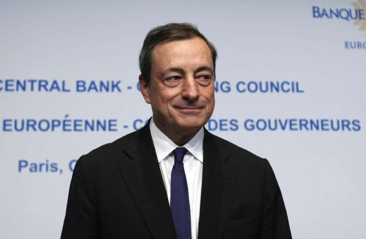 President of the European Central Bank (ECB) Mario Draghi attends a news conference of the European Central Bank at the French National Bank in Paris, Wednesday, Oct. 2, 2013. The governing council of the European Central Bank met in Paris to set the benchmark interest rate for the eurozone; economists and investors look to the meeting to see where the bank thinks the European economy is headed. (AP Photo/Michel Spingler)