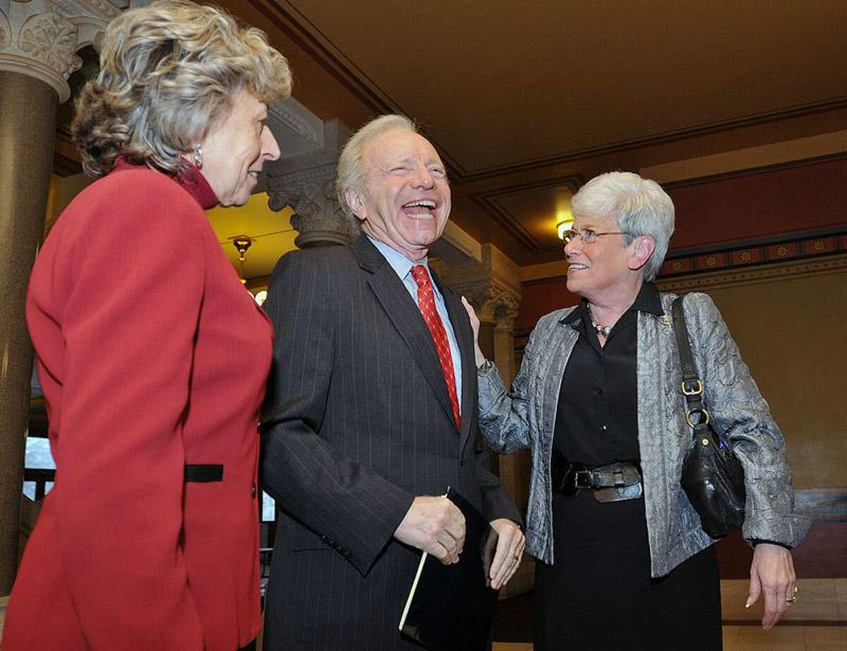 Sen. Joseph Lieberman shares a laugh with Lt. Governor Nancy Wyman and his wife, Hadassah, before a press conference Monday at the Capitol building in Hartford. Lieberman announced he will start a scholarship fund for Connecticut high school students. Peter Casolino/Register