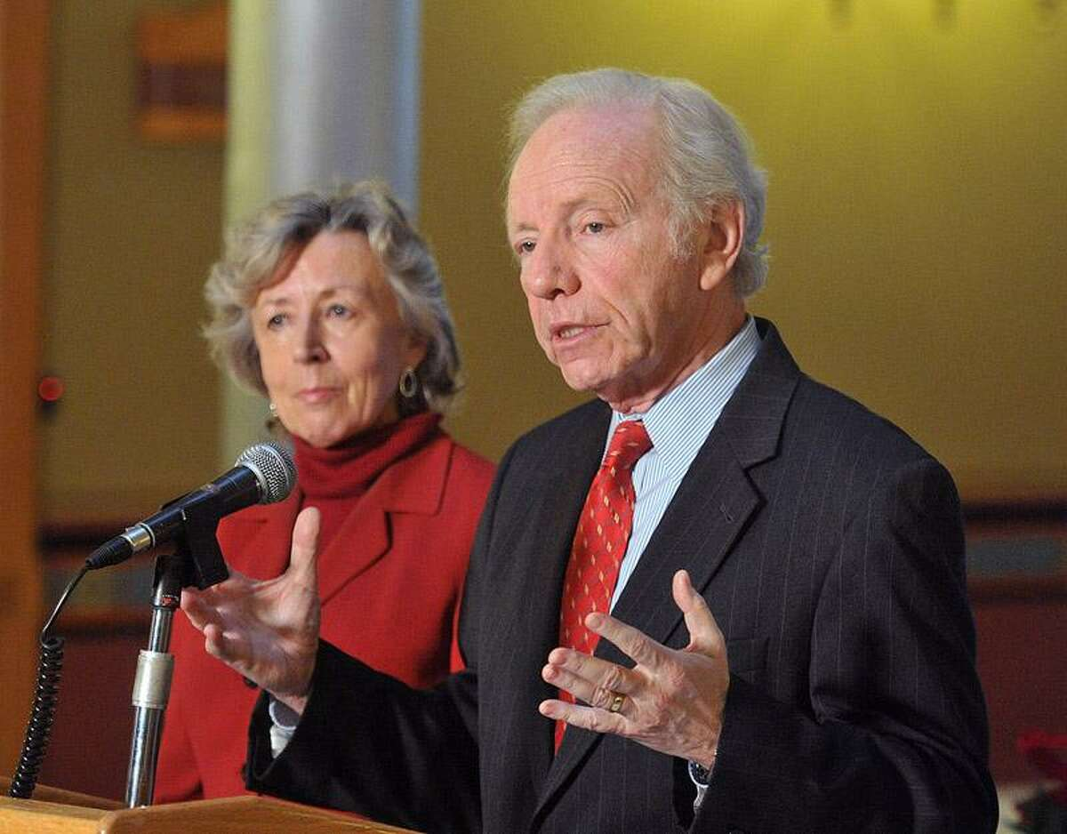 Lieberman, along with his wife, Hadassah, announces he will start a scholarship fund for Connecticut students during a press conference Monday at the state capitol. Peter Casolino/Register
