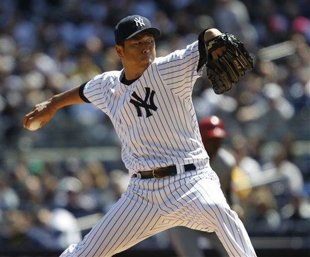 New York Yankees starting pitcher Hiroki Kuroda, of Japan, delivers ]against the Los Angeles Angels during the first inning of Yankees home opener baseball game at Yankee Stadium in New York, Friday, April 13, 2012. (AP Photo/Kathy Willens)
