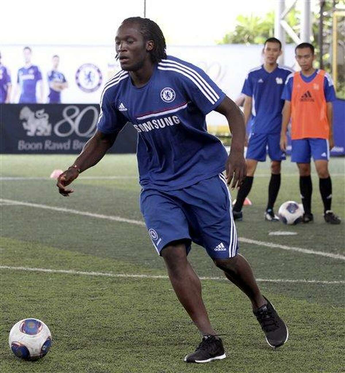 Romelu Lukaku of Chelsea shows his soccer skill to Thai youth during a soccer coaching clinic for Thai students in Bangkok, Thailand Monday, July 15, 2013. Chelsea will play against Thailand Singha All Star on Wednesday, July 17, 2013. (AP Photo/Apichart Weerawong)