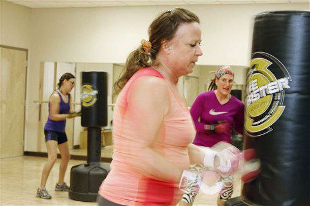 Ellen Sliwinski of Jackson works on a fast punch series during a kickboxing class at the Jackson Area Community Center on Monday night. The class focuses on cardio exercise and a series of punches and kicks. (AP Photo/The Daily News, John Ehlke)