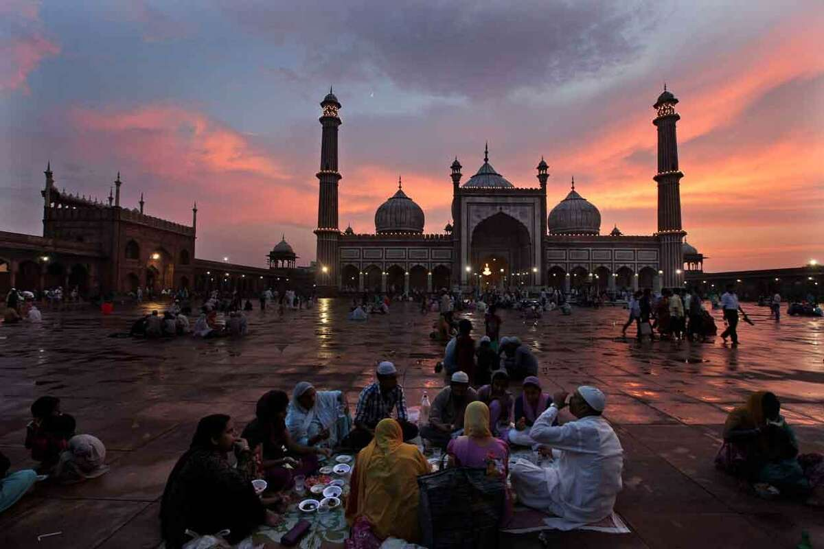 Indian Muslims break their Ramadan fast in New Delhi, India, Friday, July 12, 2013. Muslims throughout the world are marking the month of Ramadan, the holiest month in Islamic calendar during which devotees fast from dawn till dusk. (AP Photo/Manish Swarup)