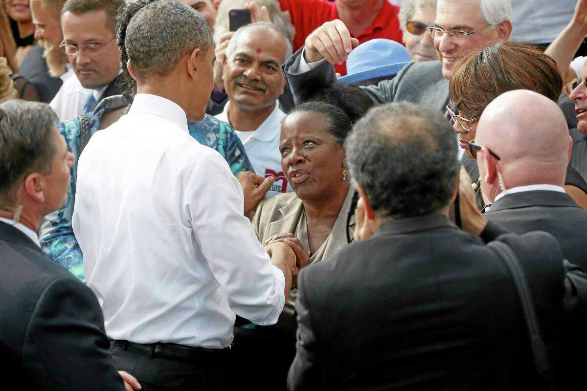 President Barack Obama greets guests after he speaking about the government shutdown and debt ceiling during a visit to M. Luis Construction, which specializes in asphalt manufacturing, concrete paving, and roadway reconstruction, Thursday, Oct. 3, 2013, in Rockville, Md. (AP Photo/Charles Dharapak)