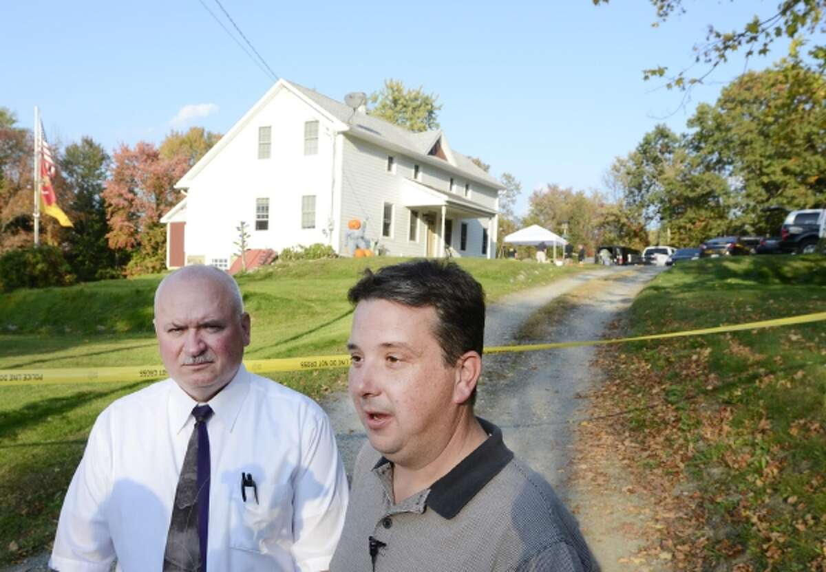New York State Police investigator Eric Cullum and East Greenbush Police detective Matt Breig speak to media about investigation of a body found by contractors at 146 Michael Road Wednesday, October 2, 2013 in East Greenbush, N.Y.