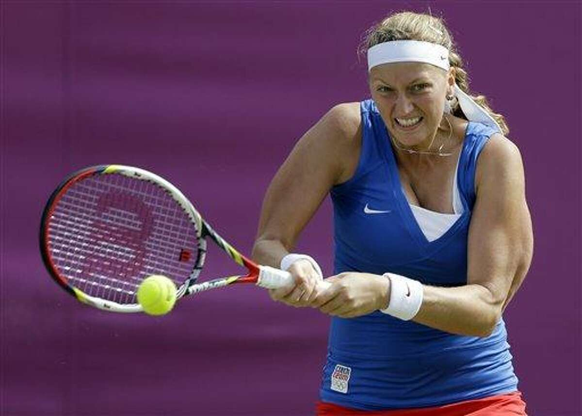 Petra Kvitova of the Czech Republic returns a shot to Flavia Pennetta of Italy at the All England Lawn Tennis Club at Wimbledon, in London, at the 2012 Summer Olympics, Wednesday, Aug. 1, 2012. (AP Photo/Mark Humphrey)