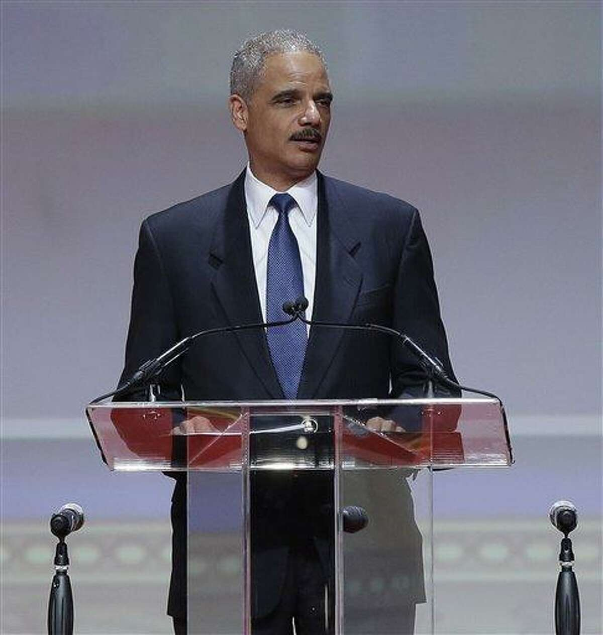 """Attorney General Eric Holder speaks at the Delta Sigma Thetas Social Action luncheon, part of the sorority's 51st National Convention in Washington, Monday, July 15, 2013. Holder said the killing of Trayvon Martin was a """"tragic, unnecessary shooting"""" and that the 17-year-old's death provides an opportunity for the nation to speak honestly about complicated and emotionally charged issues. In his first comments since the acquittal of George Zimmerman in the Martin case, the attorney general said that Martin's parents have suffered a pain that no parent should have to endure. He said the nation must not forgo an opportunity toward better understanding of one another. (AP Photo/Pablo Martinez Monsivais)"""