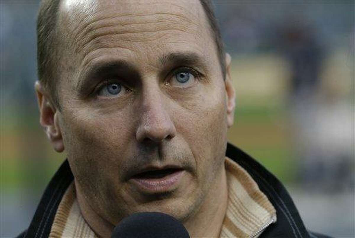 New York Yankees general manager Brian Cashman listens to a question from the media before Game 4 of the American League championship series against the Detroit Tigers Wednesday, Oct. 17, 2012, in Detroit (AP Photo/Paul Sancya )