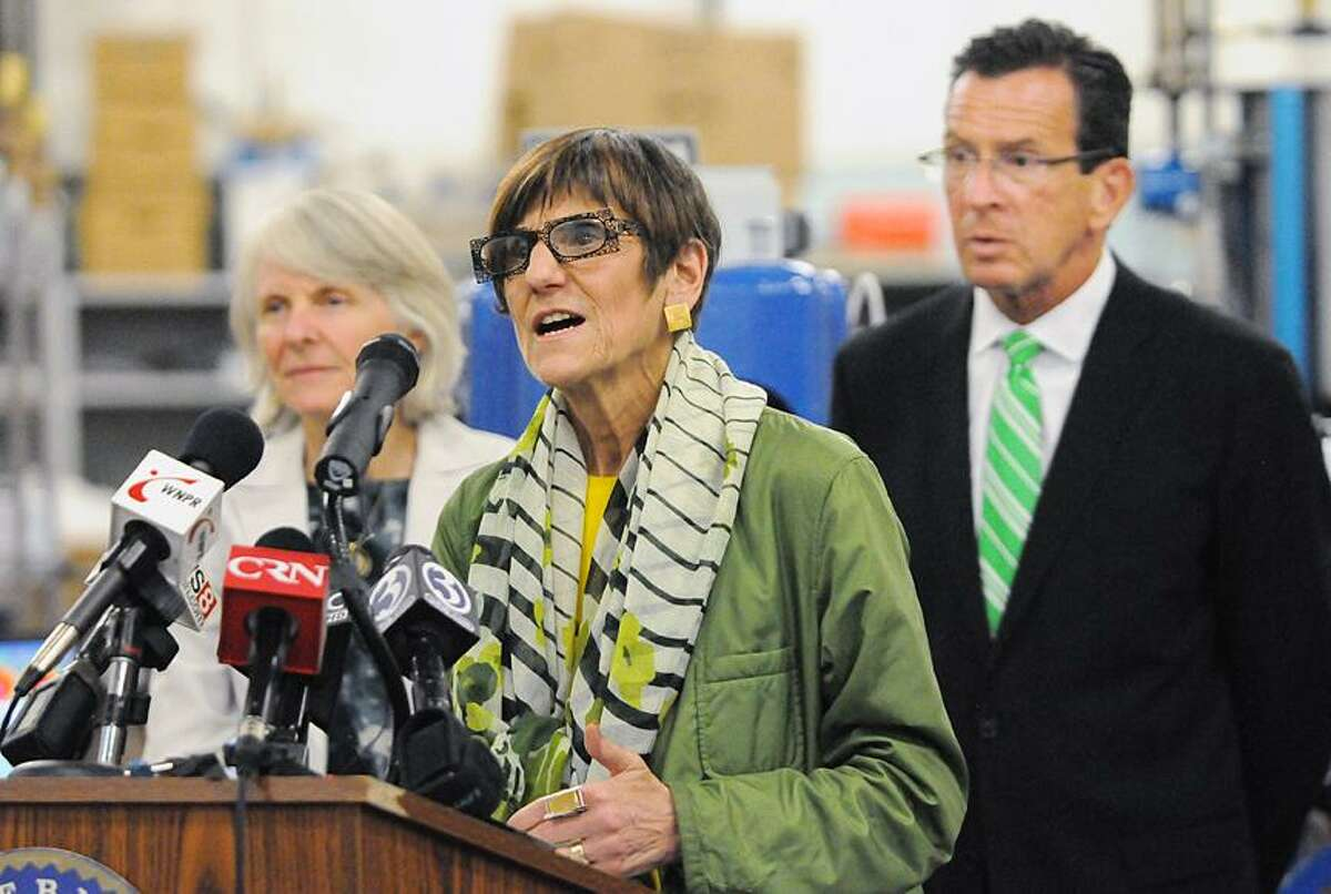 Catherine Avalone - The Middletown Press Congresswoman Rosa DeLauro speaks before Governor Dannel P. Malloy signed the Public Act 13-56 - ACC which will assist small businesses in Connecticut pursuing global commerce which will help promote more Connecticut products into foreign markets Monday afternoon at Test Logic at 17 Kenneth Dooley Drive in Middletown.