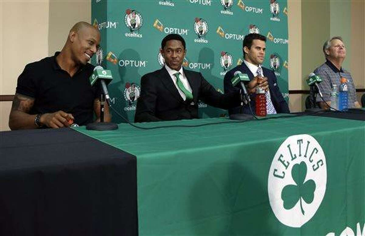 Newly acquired Boston Celtics players, from left, Keith Bogans, MarShon Brooks and Kris Humphries listen to a question along with Celtics president of basketball operations Danny Ainge, far right, in Waltham, Mass., Monday, July 15, 2013, during an NBA basketball news conference to introduce players they acquired from the Brooklyn Nets in exchange for Kevin Garnett and Paul Pierce. (AP Photo/Elise Amendola)