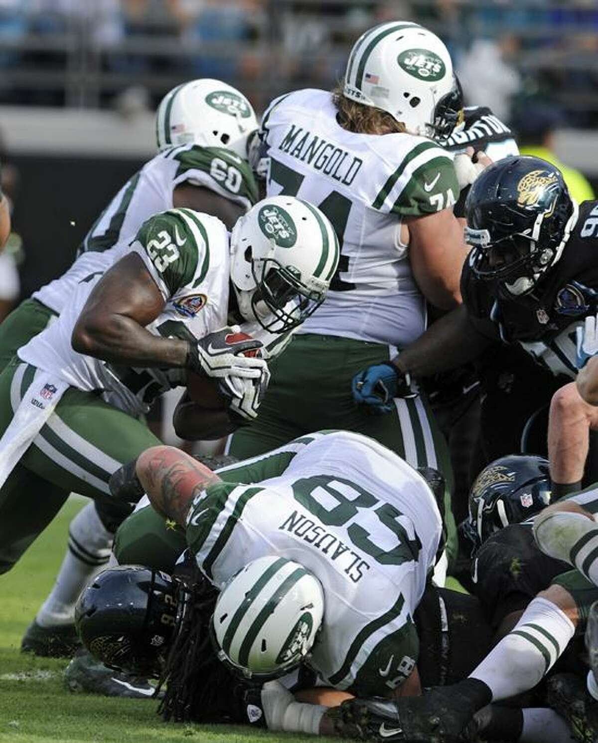 New York Jets running back Shonn Greene (23) runs a 1-yard touchdown past the Jacksonville Jaguars during the second half of an NFL football game, Sunday, Dec. 9, 2012, in Jacksonville, Fla. (AP Photo/Stephen Morton)