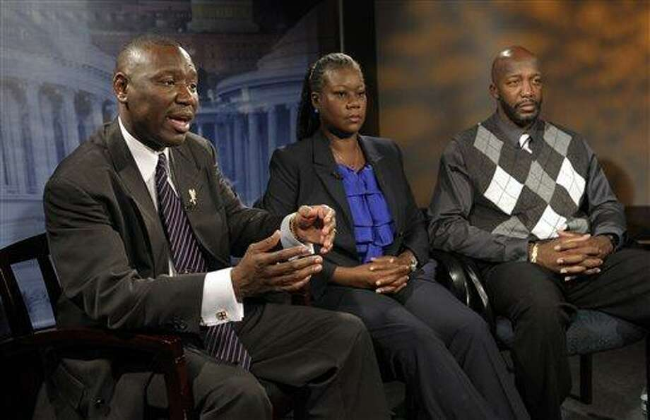 Ben Crump, left, attorney for Trayvon Martin's parents, left, and The Martin's parents, mother Sybrina Fulton, center, and father Tracy Martin are interviewed by The Associated Press in Washington, Wednesday. After weeks of mounting tension and protests across the U.S., a special prosecutor has decided to bring charges against neighborhood watch volunteer George Zimmerman in the killing of 17-year-old Trayvon Martin, a law enforcement official said Wednesday. Associated Press Photo: AP / AP