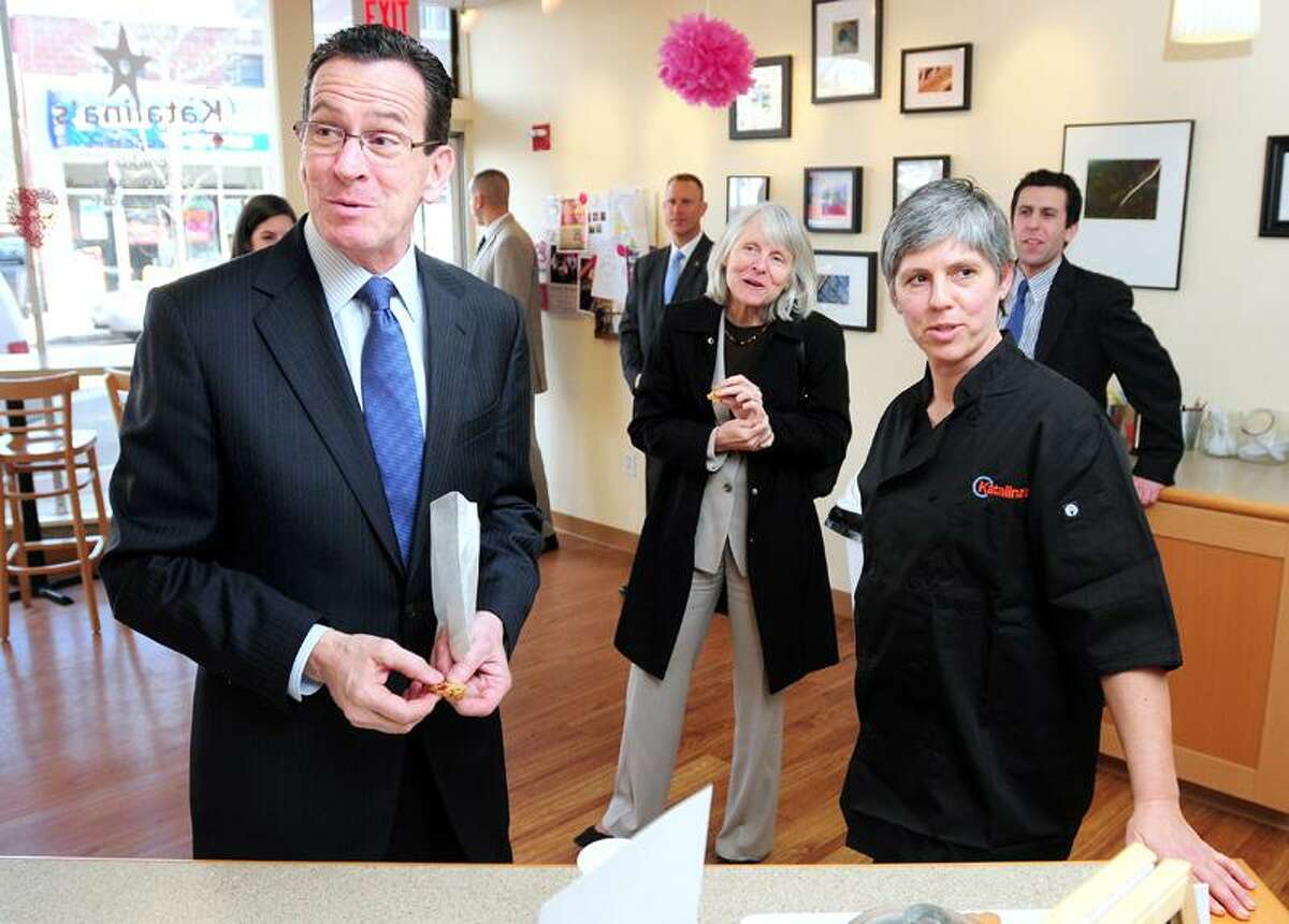 Governor Dannel Malloy (left) speaks with Kathy Riegelmann (right), owner of Katalina's, in New Haven on 3/4/2013. At center is Catherine Smith, Commissioner of the Connecticut Dept. of Economic and Community Development. Katalina's is a recipient of funds from the Small Business Express Program administered by the Connecticut Dept. of Economic and Community Development.Photo by Arnold Gold/New Haven Register AG0485F