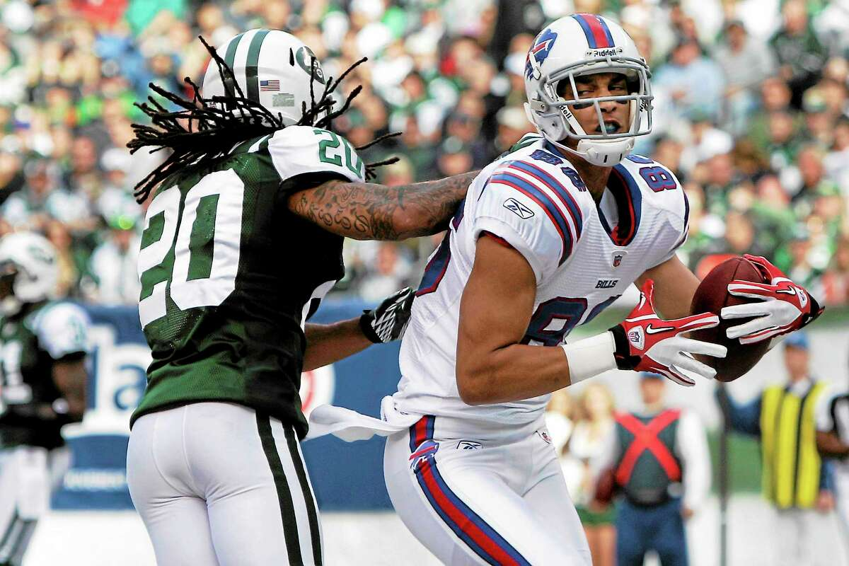 Buffalo Bills wide receiver David Nelson reacts after catching a touchdown in front of New York Jets defensive back Kyle Wilson during a Nov. 27, 2011, game in East Rutherford, N.J.