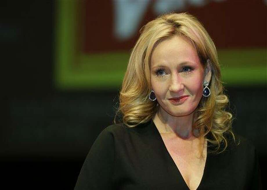 """In this Sept. 27, 2012 file photo, British author J.K. Rowling poses for photographers during a photo call to unveil her new book, entitled: 'The Casual Vacancy', at the Southbank Centre in London. British author J.K. Rowling confirmed Sunday, July 14, 2013 in a statement released by her publicist that """"The Cuckoo's Calling"""", a detective novel which won critical acclaim, was penned under her pseudonym Robert Galbraith. (AP Photo/Lefteris Pitarakis, File) Photo: AP / AP"""