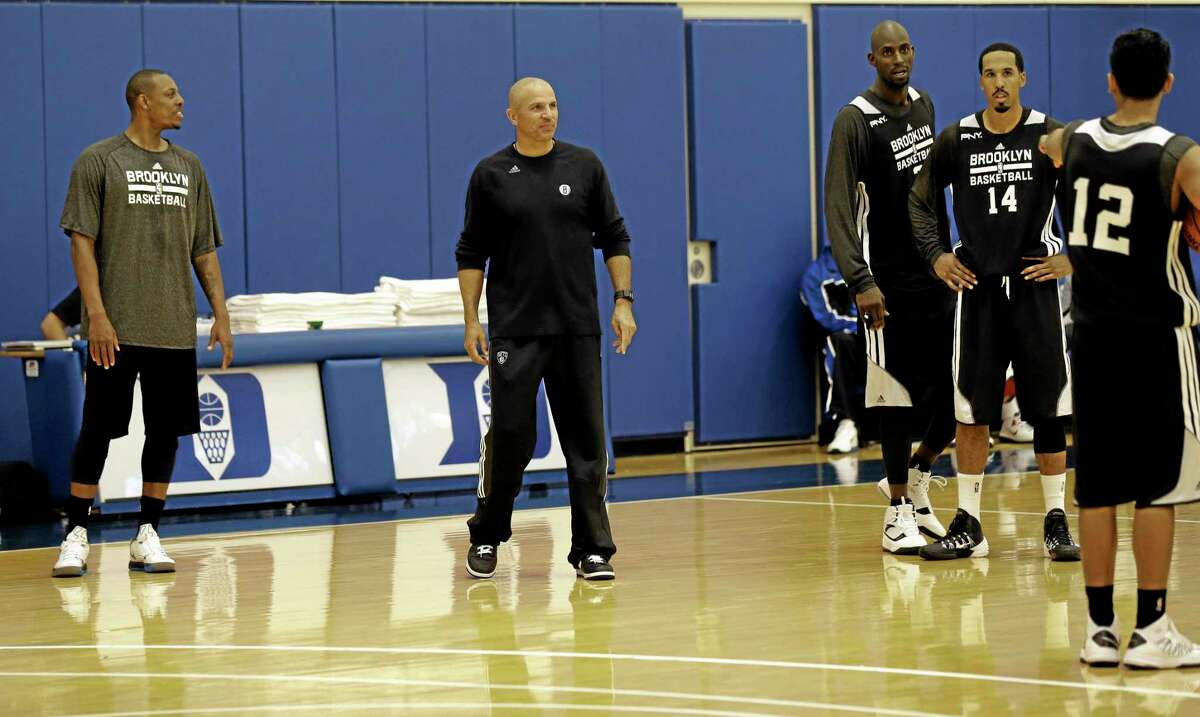 Brooklyn Nets coach Jason Kidd, second from left, works with players during training camp on Tuesday at Duke University in Durham, N.C.