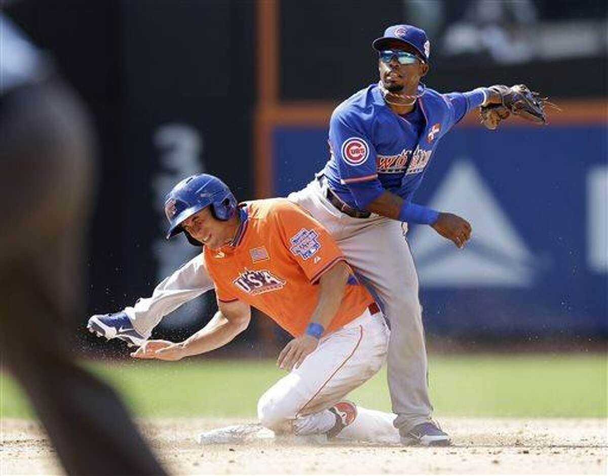 United States' George Springer is out at second base as he collides with World's Arismendy Alcantara in the fifth inning of the MLB All-Star Futures baseball game on Sunday, July 14, 2013 in New York. (AP Photo/Kathy Willens)