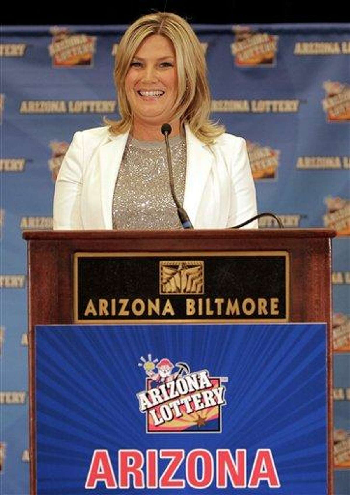 Arizona Lottery Director of Budget, Products and Communications Karen Bach speaks during a news conference Friday, Dec. 7, 2012 in Scottsdale, Ariz. The Lottery held the news conference to announce that the Arizona Lottery Powerball jackpot winning ticket has been claimed by an unidentified Arizona man. The $587.5 million jackpot is the largest in Powerball history and will be shared by co-winners Mark and Cindy Hill from Missouri. (AP Photo/Matt York)