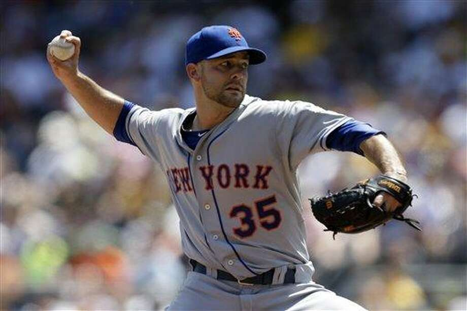 New York Mets starting pitcher Dillon Gee (35) delivers in the second inning of a baseball game against the Pittsburgh Pirates in Pittsburgh Sunday, July 14, 2013. The Mets won 4-2, with Gee getting the win. (AP Photo/Gene J. Puskar) Photo: AP / AP