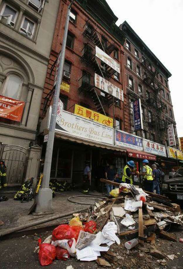Debris is seen outside a five-story building that partially collapsed after a reported explosion in New York July 11, 2013. Photo: REUTERS / X90033