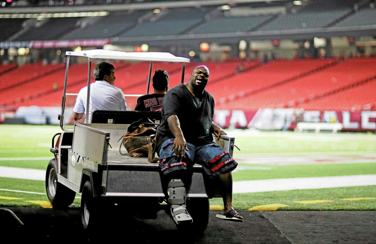 New England Patriots defensive tackle Vince Wilfork is transported out of the Georgia Dome after he was injured during the second half of Sunday night's game against the Atlanta Falcons.