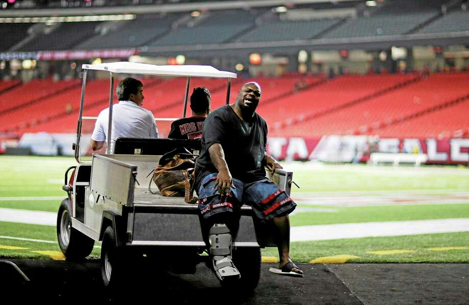 New England Patriots defensive tackle Vince Wilfork is transported out of the Georgia Dome after he was injured during the second half of Sunday night's game against the Atlanta Falcons. Photo: David Goldman — The Associated Press  / AP2013