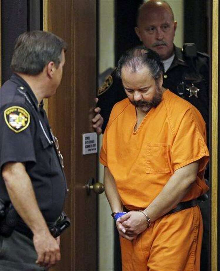 FILE - In this July 3, 2013 file photo, Ariel Castro is led into Cuyahoga County Common Pleas Court in Cleveland for a pretrial hearing.   A 977-count indictment against Castro was filed Friday, July 12, 2013 including aggravated murder, kidnapping and rape charges, but does not yet carry death penalty specifications. (AP Photo/Mark Duncan, File) Photo: AP / ap