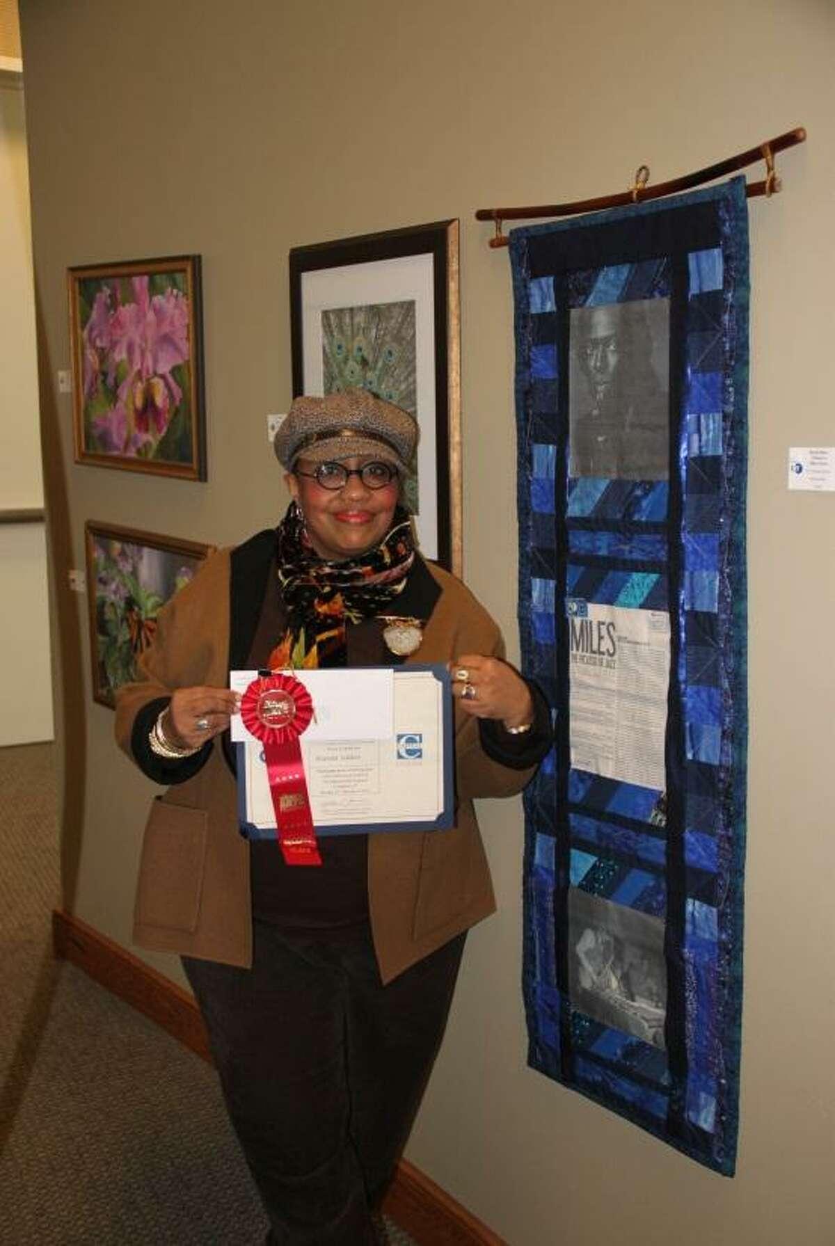 Wanda Seldon of Hartford displays her winning certificate from last year's show.