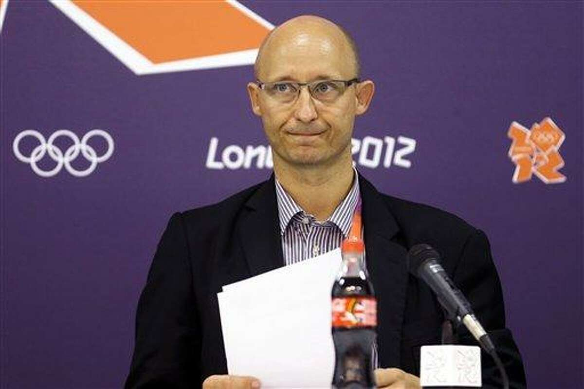 """Chief Operating Officer Thomas Lund, of the Badminton World Federation, speaks during a news conference announcing the elimination of eight female badminton doubles players at the 2012 Summer Olympics, Wednesday, Aug. 1, 2012, in London. The Badminton World Federation announced its ruling after investigating two teams from South Korea and one each from China and Indonesia. It punished them for """"not using one's best efforts to win a match"""" and """"conducting oneself in a manner that is clearly abusive or detrimental to the sport"""" in matches Tuesday night. (AP Photo/Markus Schreiber)"""