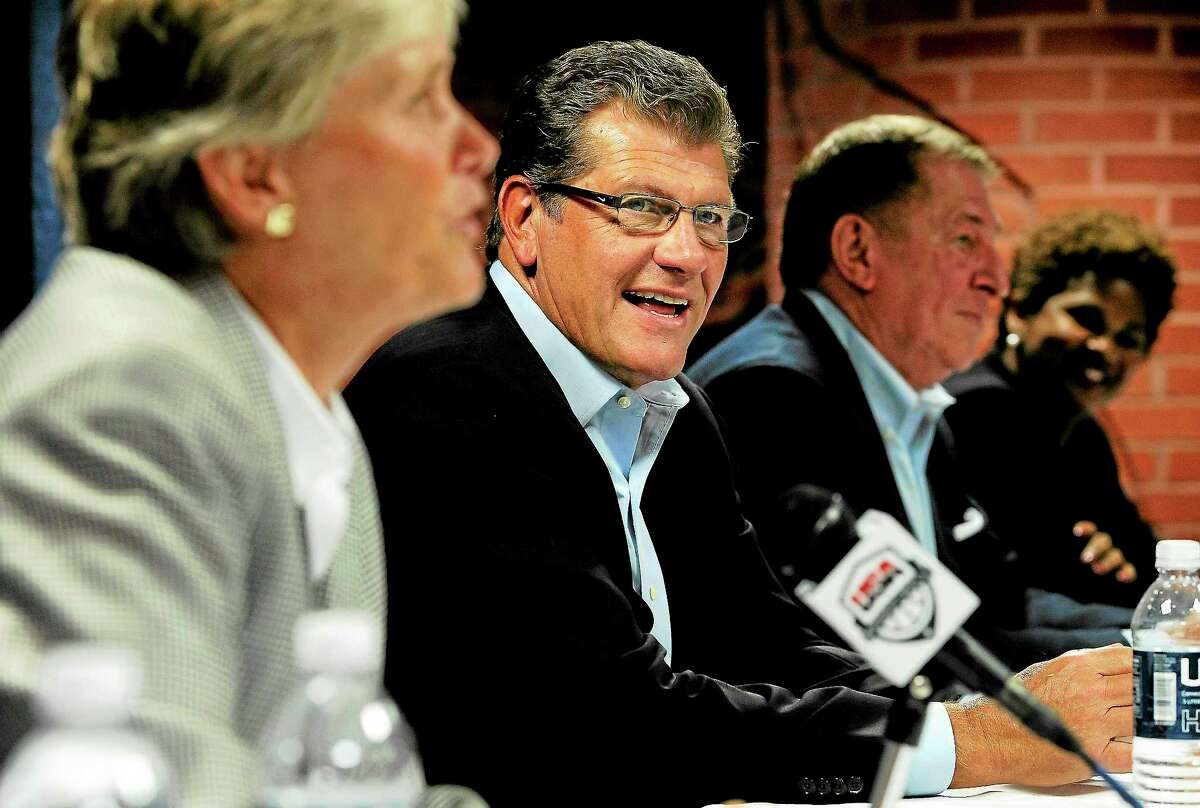 September was a whirlwind month for UConn coach Geno Auriemma, second from left, who visited 14 cities in 20 days.