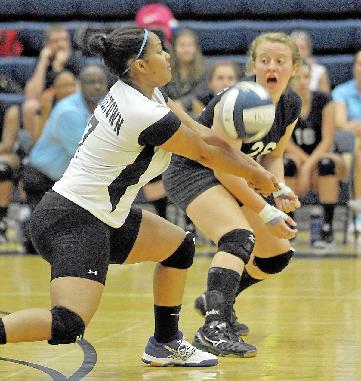 Middletown's Kyra Culup cheers on Tamyia King as she receives a serve from Bristol Eastern Wednesday evening. Bristol Eastern won all three sets, 25-15, 25-13, and 25-17.