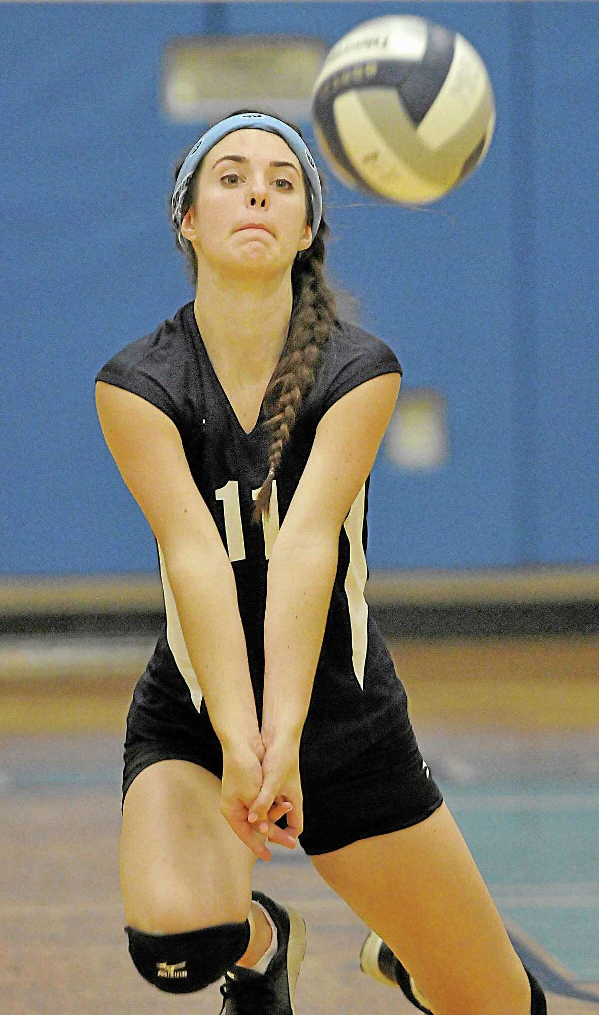 Middletown's Liza Marino receives a serve from Bristol Eastern Wednesday evening. Bristol Eastern won all three sets, 25-15, 25-13, and 25-17.