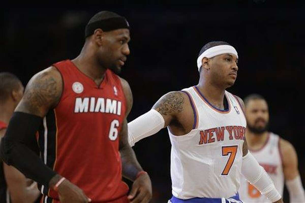 Miami Heat forward LeBron James (6), New York Knicks forward Carmelo Anthony (7) and New York Knicks center Tyson Chandler (6) are shown before their NBA basketball game at Madison Square Garden in New York, Sunday, March 3, 2013. (AP Photo/Kathy Willens)